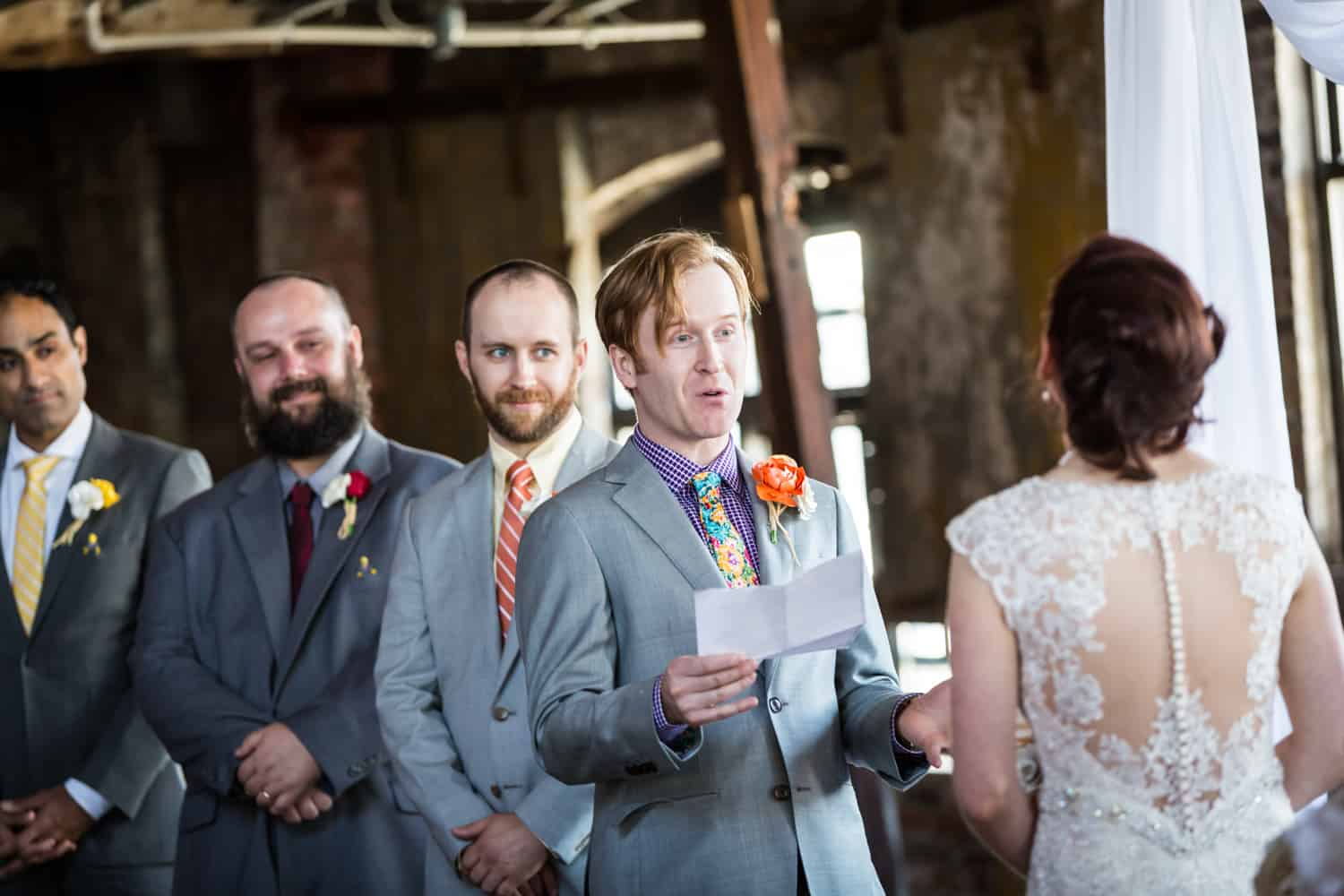 Groom reading vows at a Greenpoint Loft wedding