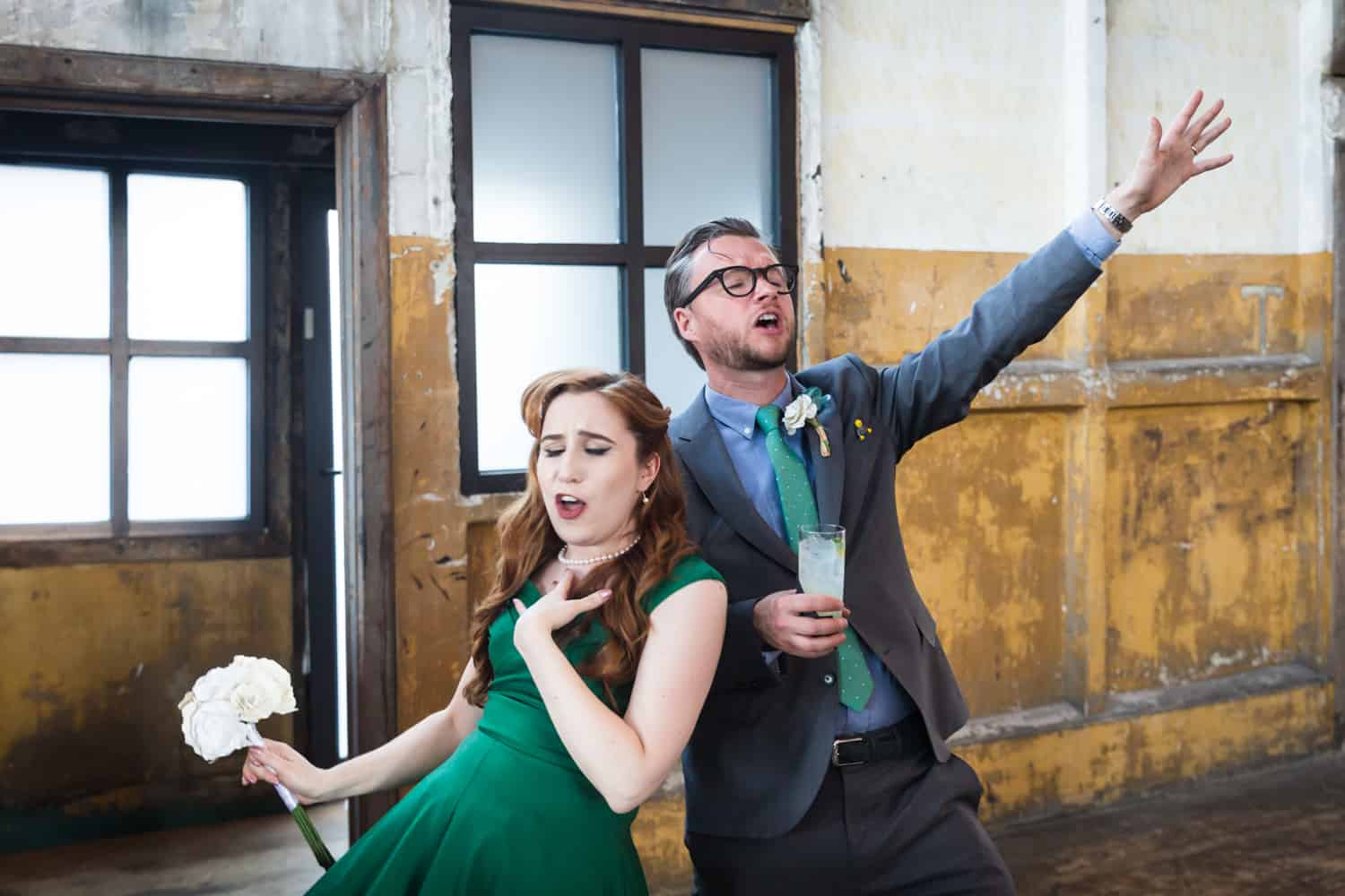 Couple singing dramatically at a Greenpoint Loft wedding