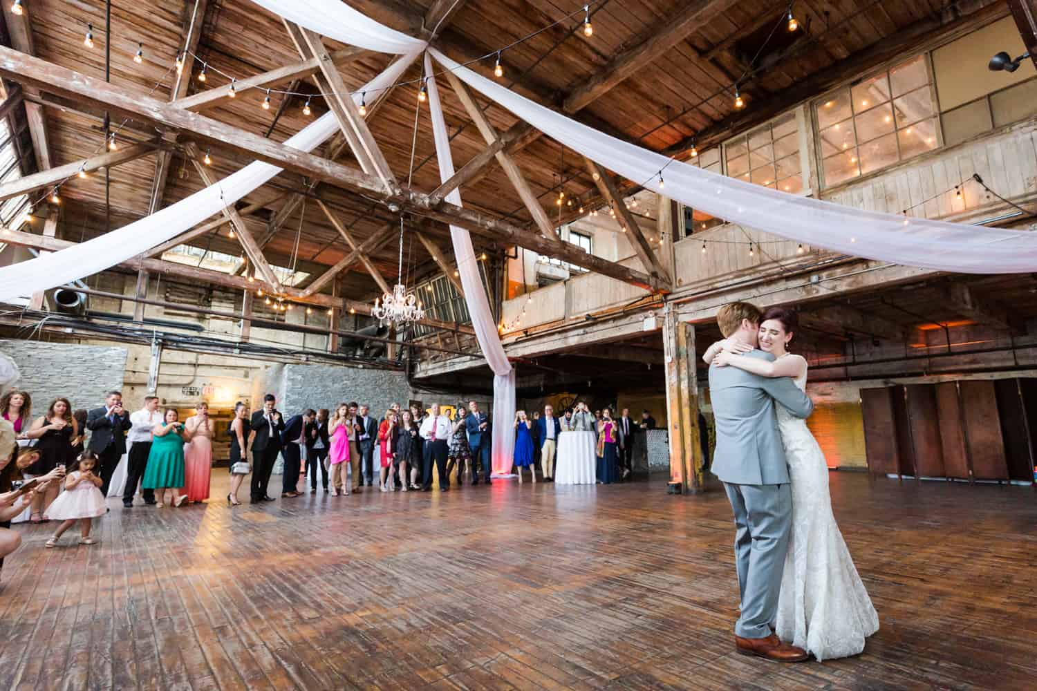 Wide shot of bride and groom during first dance at a Greenpoint Loft wedding