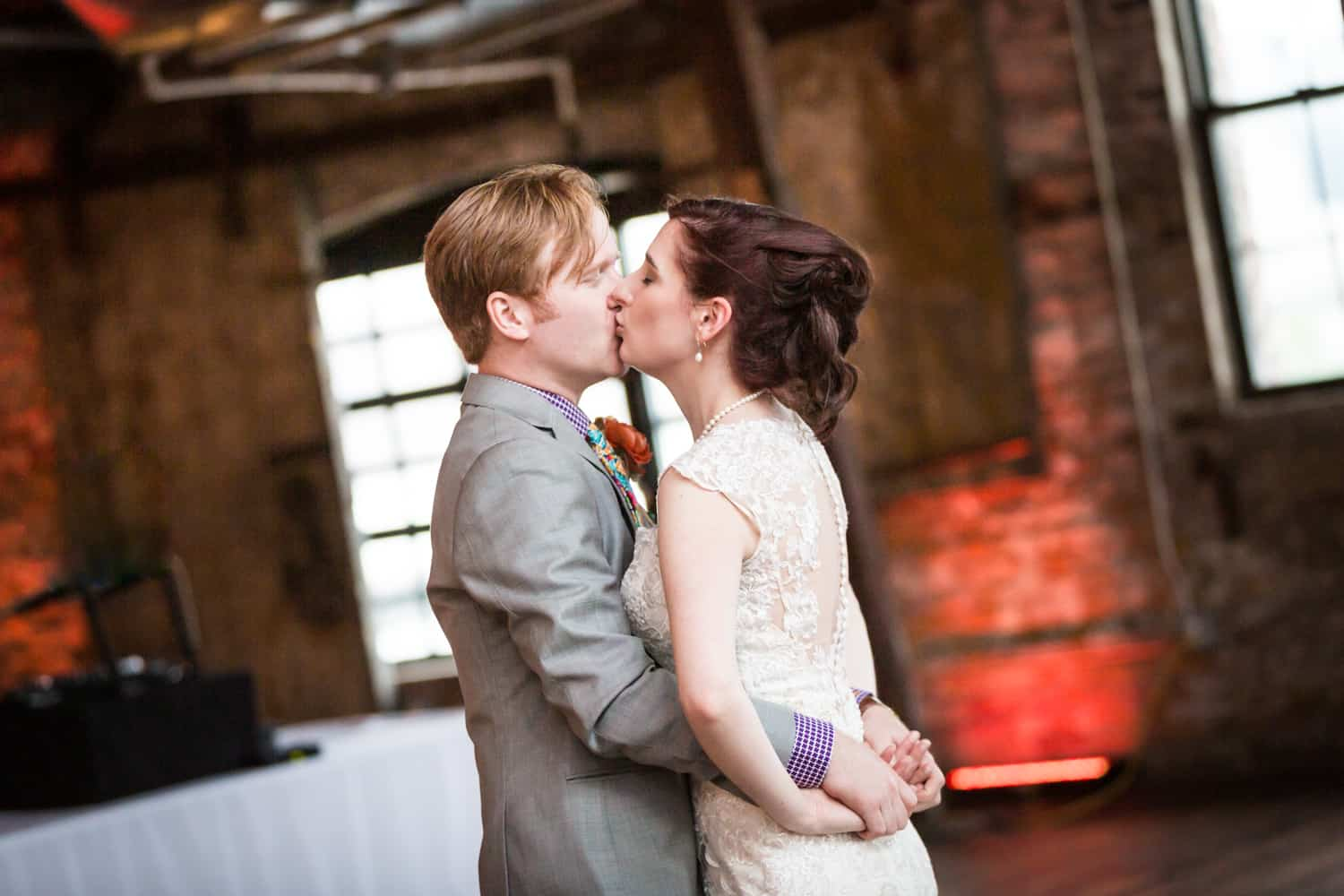 Bride and groom kissing on dance floor at a Greenpoint Loft wedding