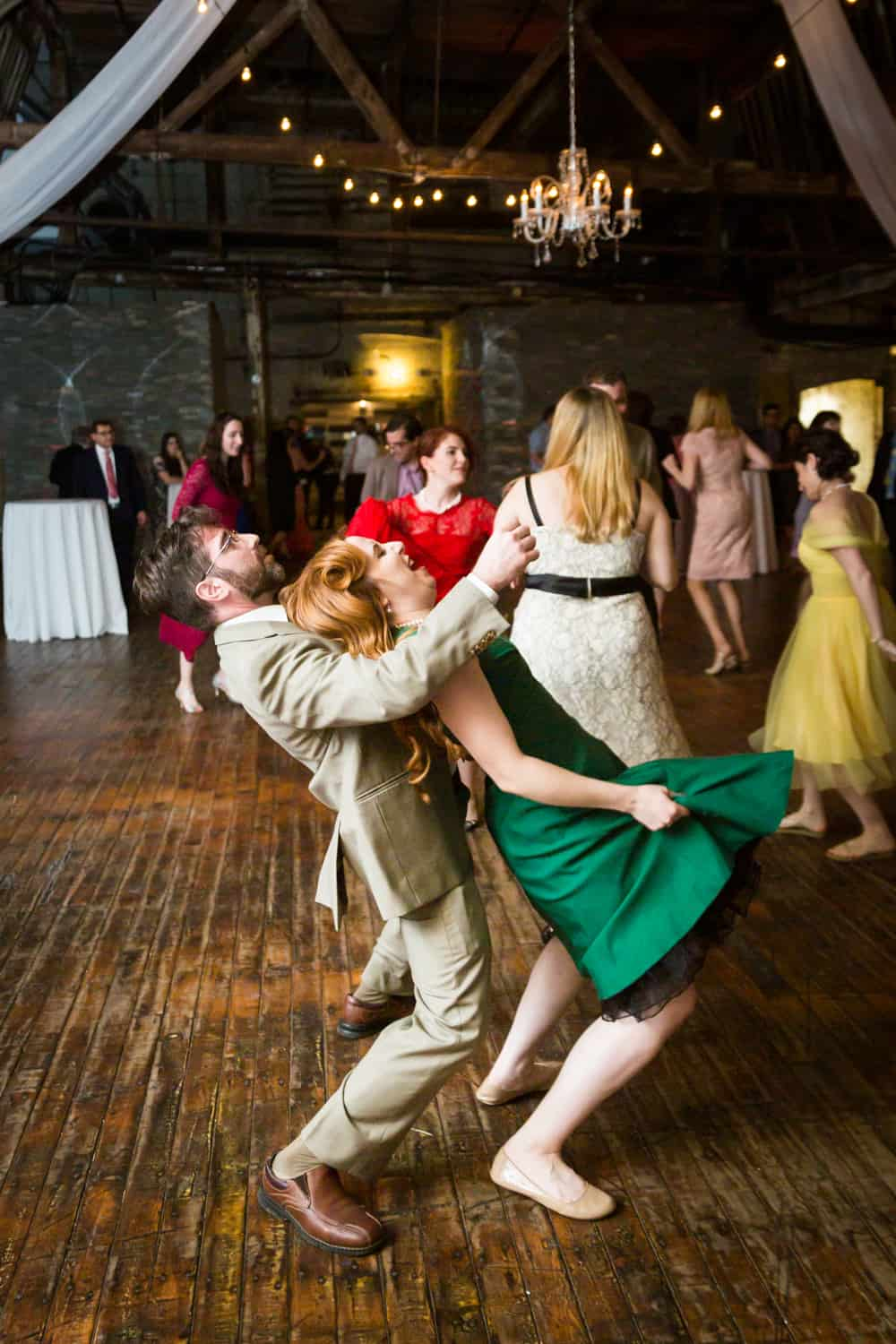 Couple dancing dramatically at a Greenpoint Loft wedding