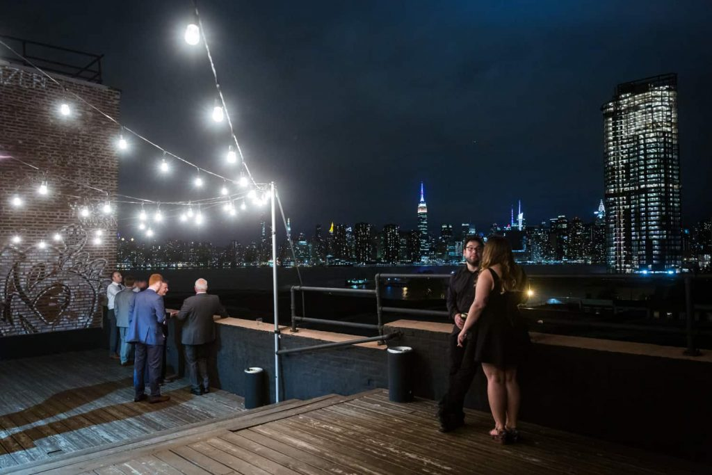 Nighttime on the roof of the Greenpoint Loft with view of NYC skyline