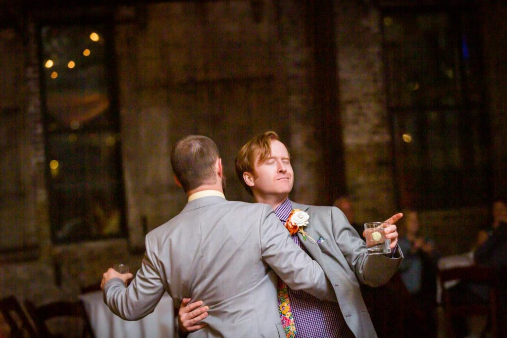 Groom and man dancing at a Greenpoint Loft wedding