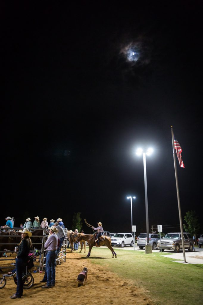 Roper under moonlight at the Bar W Rodeo