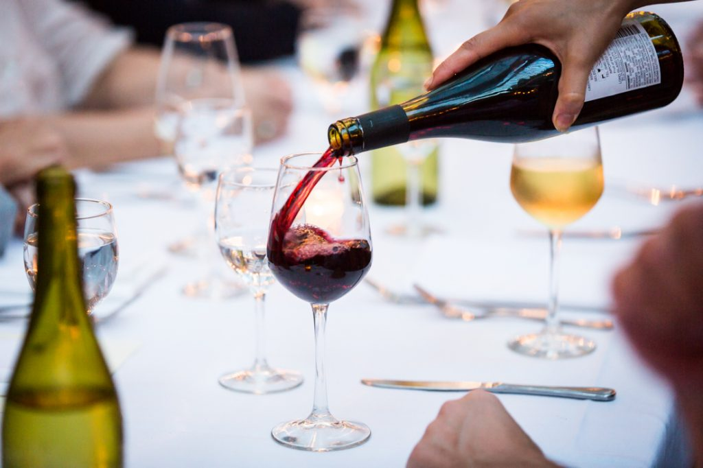 Pouring wine at a Brooklyn rehearsal dinner
