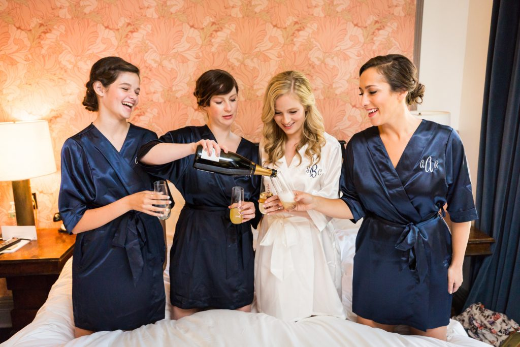 Bride and bridesmaids toasting before a Gallow Green wedding