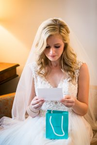 Bride opening groom's gift before a Gallow Green wedding