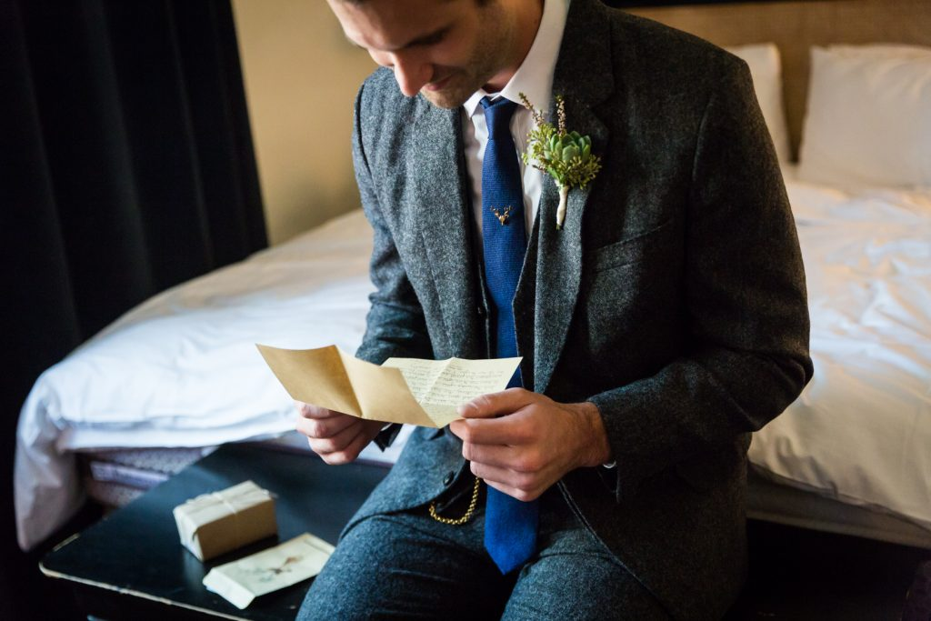 Groom opening bride's gift before a Gallow Green wedding