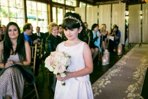 Flower girl walking down aisle for an article on wedding officiant tips