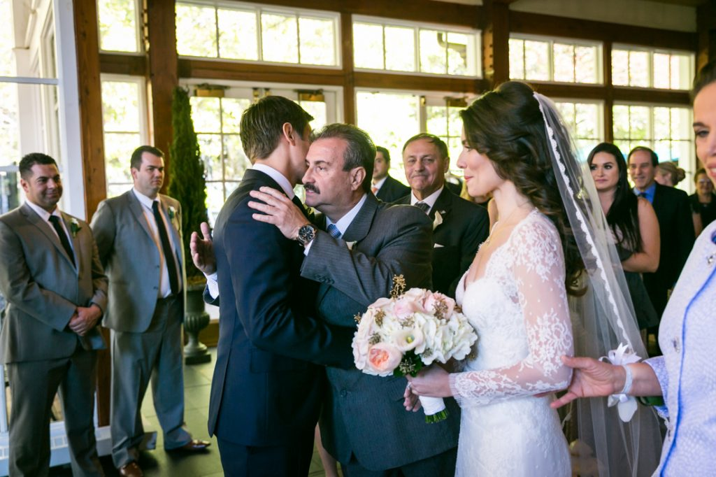 Father of bride greeting groom for an article on wedding officiant tips