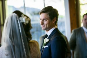 Groom looking at bride for an article on wedding officiant tips