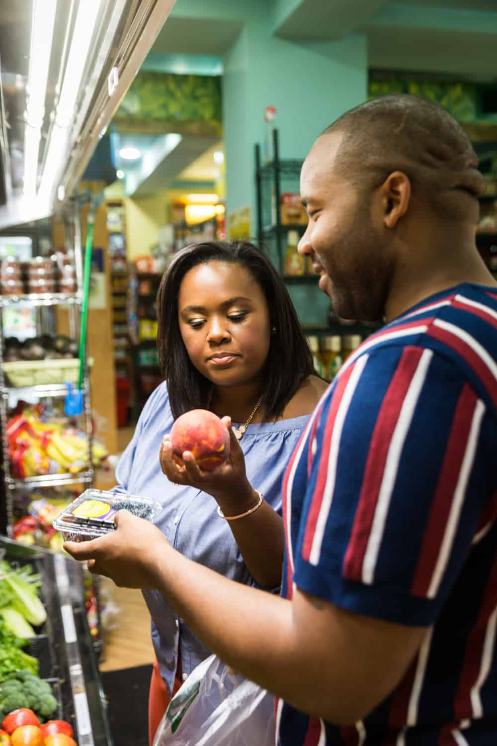 African American couple shopping for fruit together