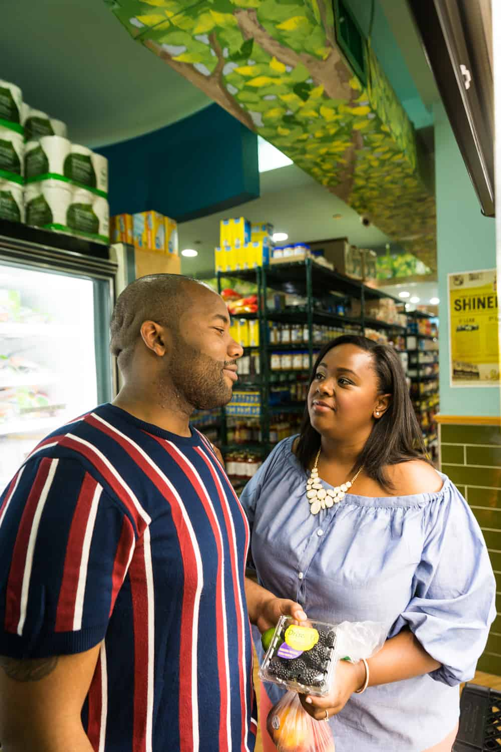African American couple shopping together in grocery store