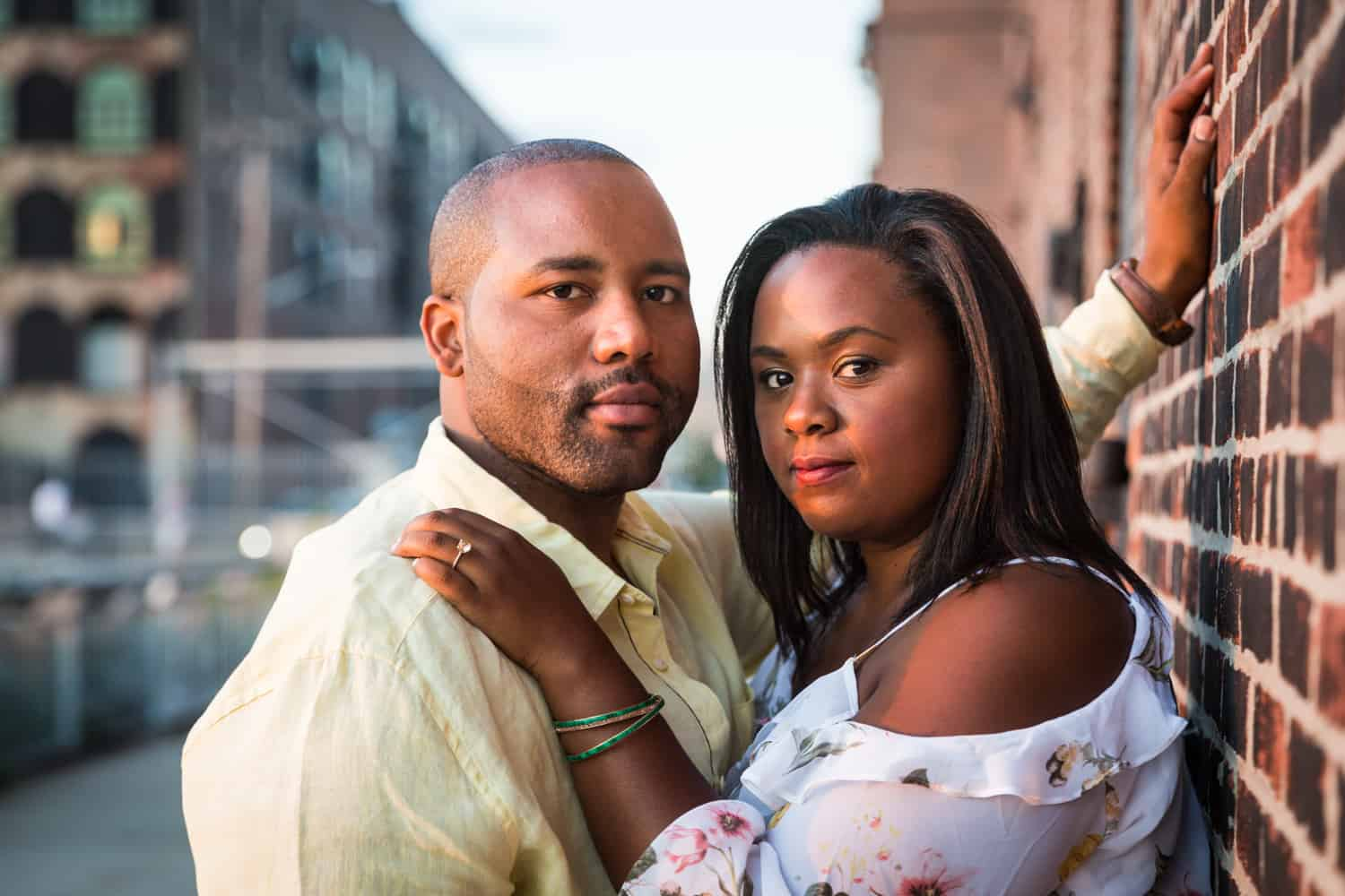 African American couple hugging during Red Hook engagement shoot