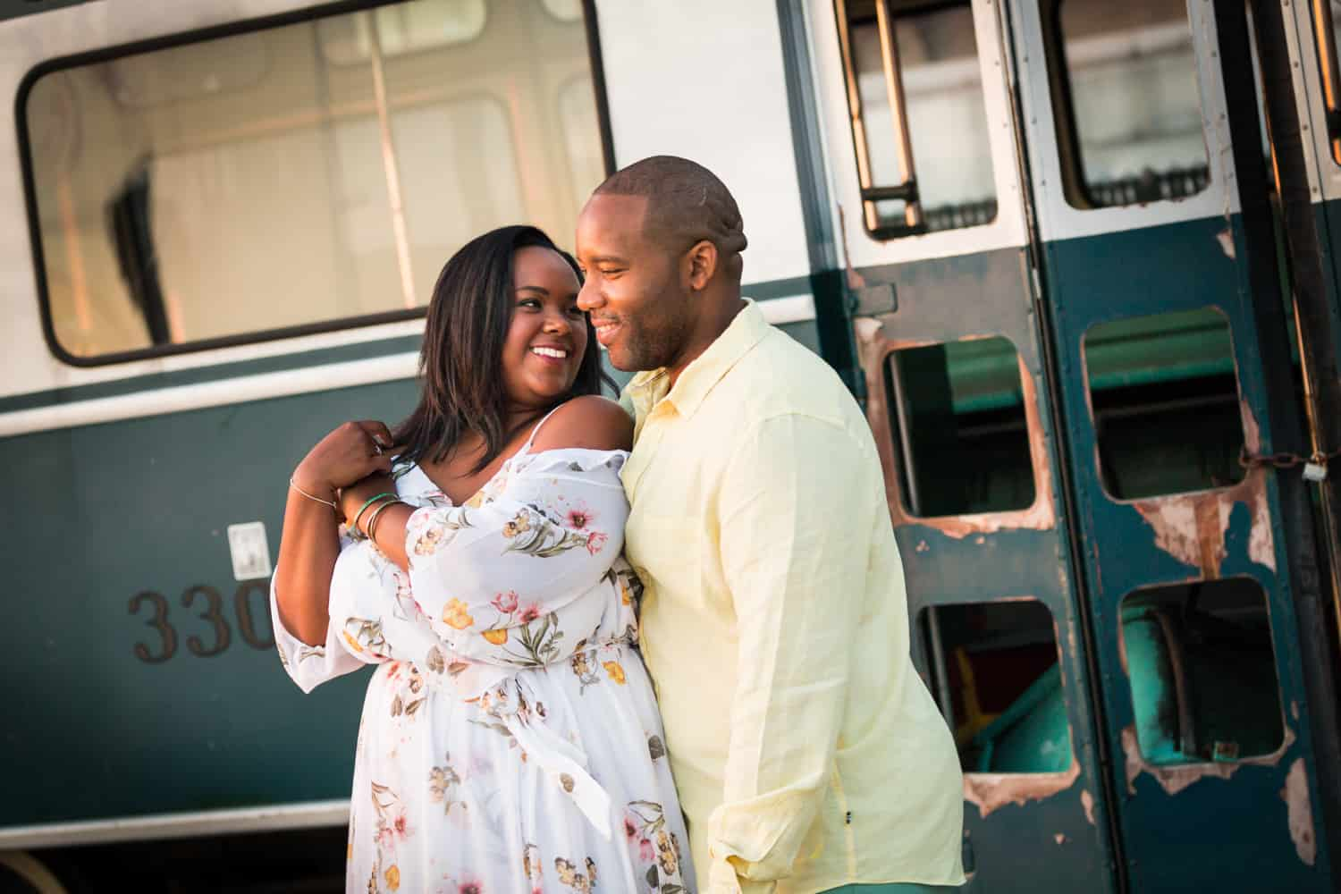 Couple in front of bus for an article on creative engagement photo shoot ideas