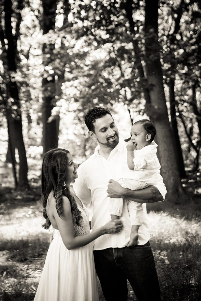 Black and white photo of parents holding son in Forest Park