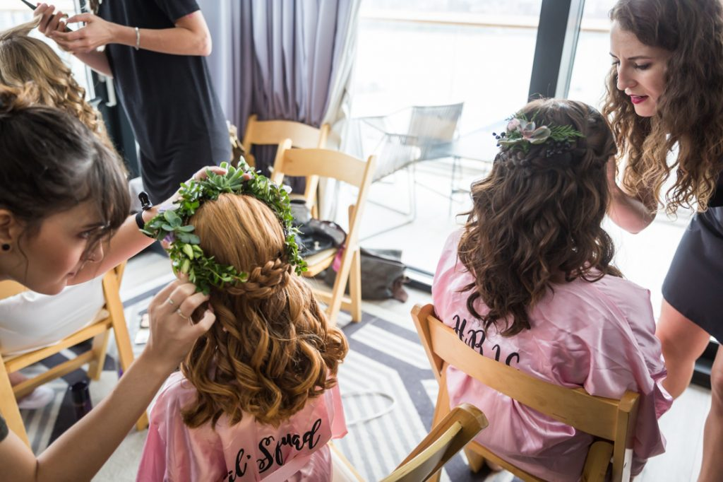 Bridesmaid and flower girl getting ready for a 26 Bridge wedding