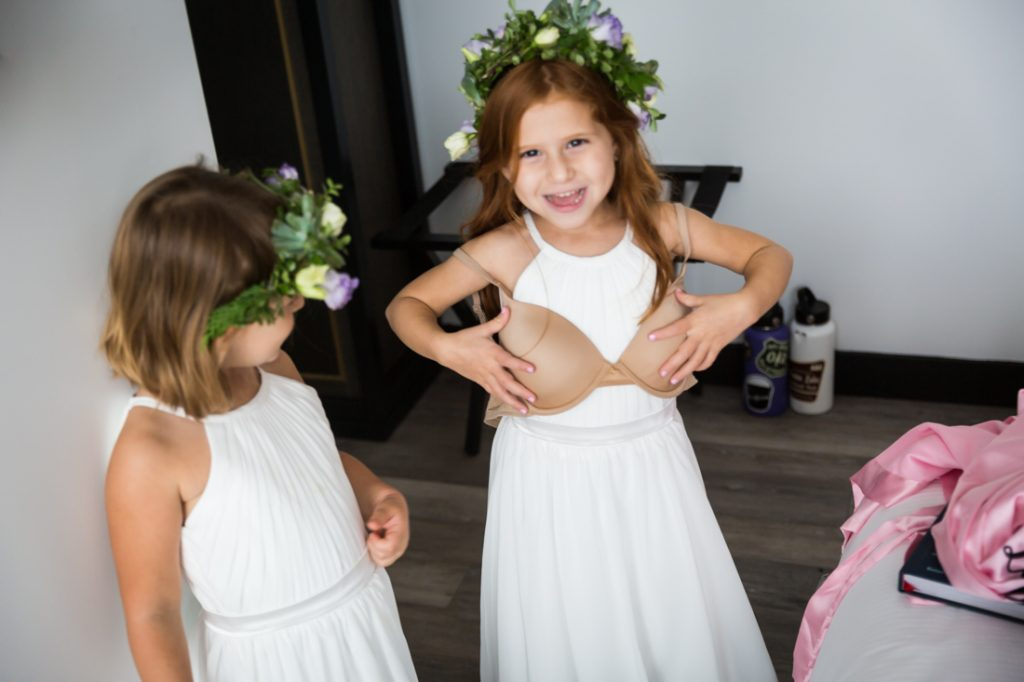 Flower girls playing before a 26 Bridge wedding