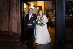 Bride and groom entering reception at a 26 Bridge wedding