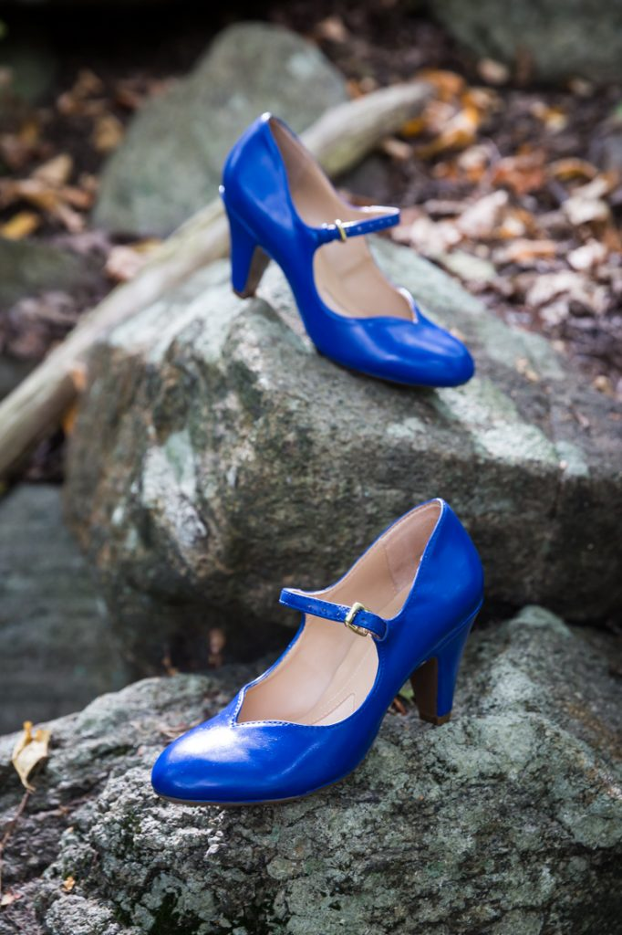 Blue wedding shoes at a Bear Mountain Carousel wedding
