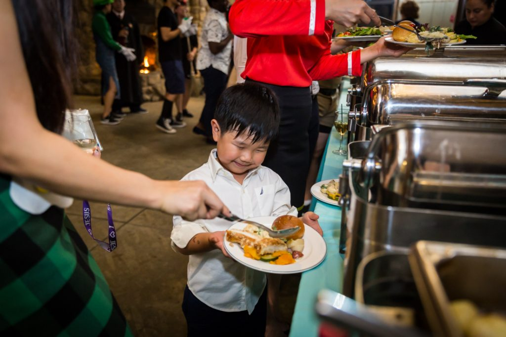 Little boy at the buffet at a Bear Mountain Carousel wedding