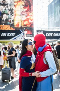 Couple dressed as Spiderman and Supergirl for a Comic Con engagement shoot
