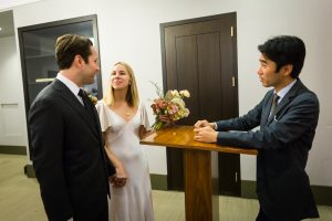 Bride and groom exchanging vows for an article on How to Get Married at City Hall in Any NYC Borough