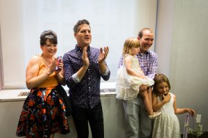 Family applauding for an article on How to Get Married at City Hall in Any NYC Borough