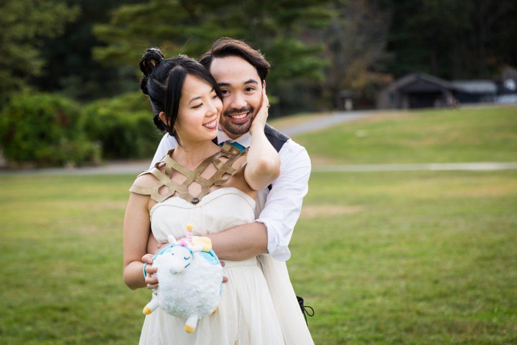 Bride touching groom's cheek at a Bear Mountain Inn wedding