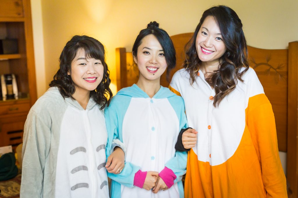Bride and two bridesmaids wearing animal-themed onesies at a Bear Mountain Inn wedding