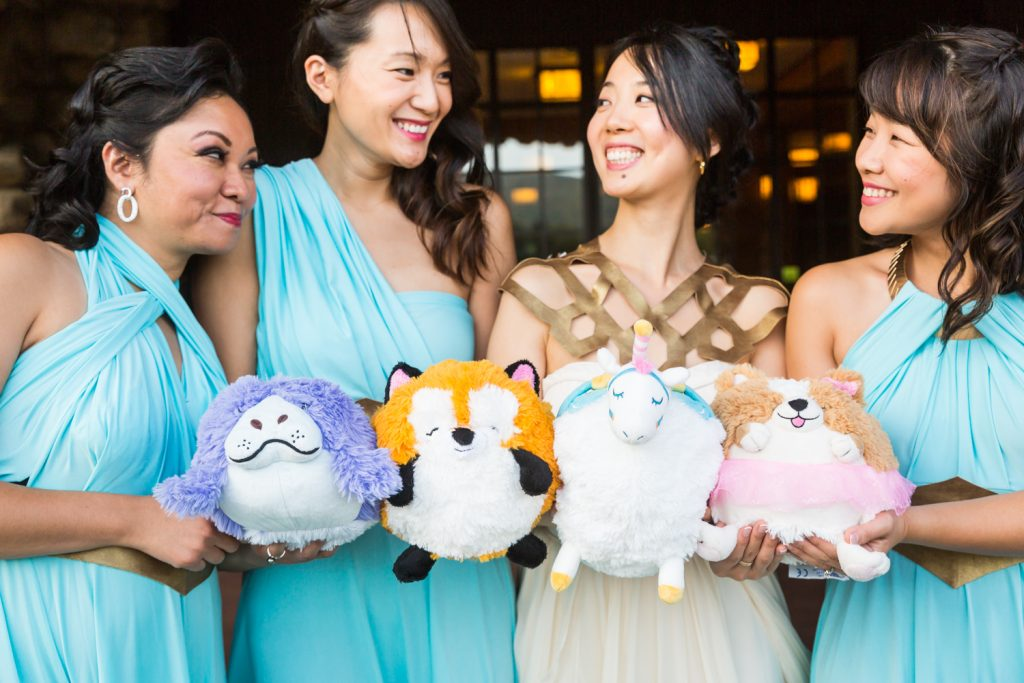 Bride and bridesmaids holding stuffed animals as bouquets at a Bear Mountain Inn wedding