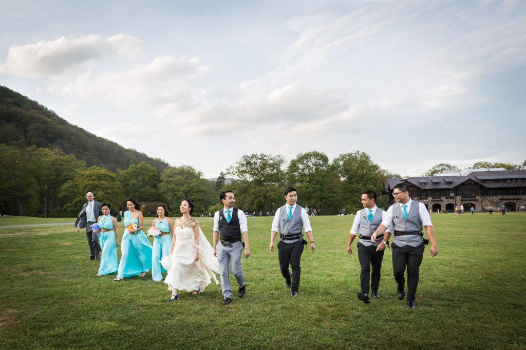 Bridal party walking across a field at a Bear Mountain Inn wedding