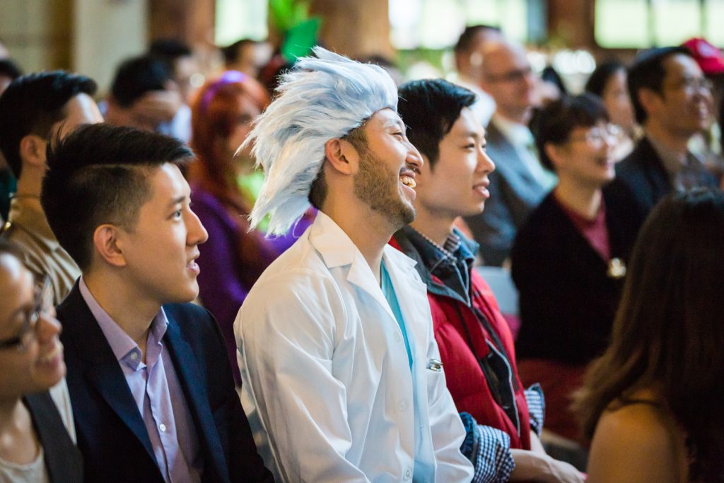 Guests dressed in costume listening to ceremony at a Bear Mountain Inn wedding