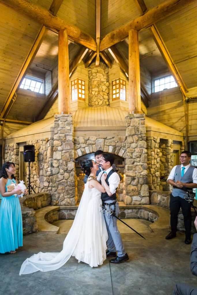 Bride and groom hugging during ceremony at a Bear Mountain Inn wedding