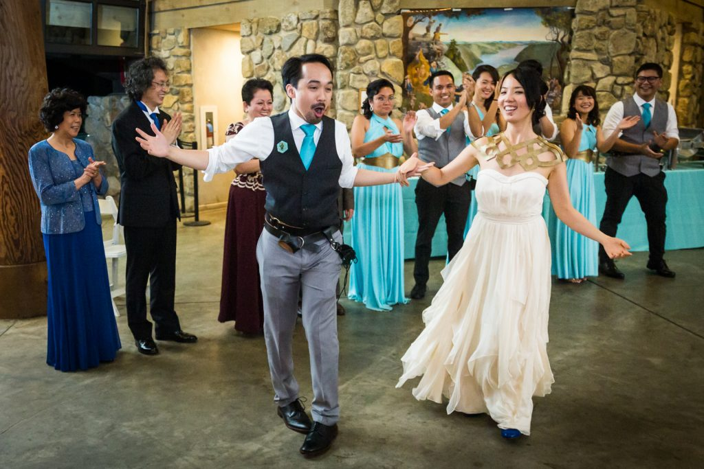 Bride and groom making entrance into reception at a Bear Mountain Inn wedding