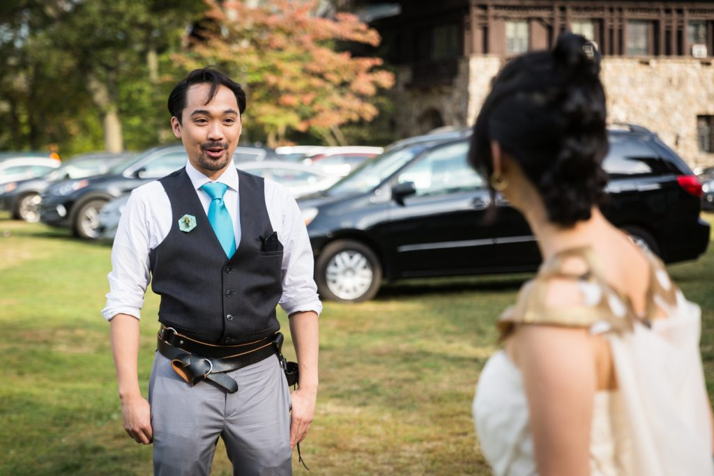 Groom seeing bride for first time at first look at a Bear Mountain Inn wedding