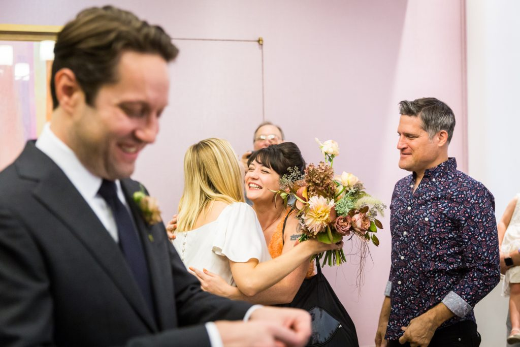 Family embracing for an article on How to Get Married at City Hall in Any NYC Borough