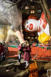 Selfie in front of balloon being inflated at the NYC Thanksgiving Parade Inflation Celebration
