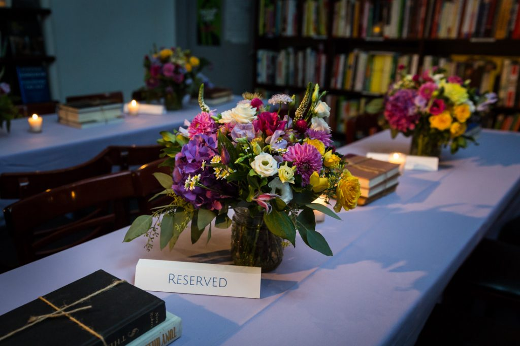 Flower centerpieces at a Housing Works Bookstore Cafe wedding