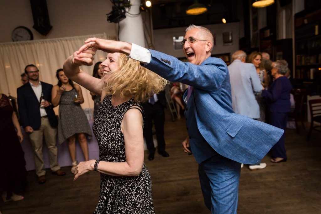 Groom and guest dancing at a Housing Works Bookstore Cafe wedding