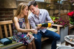 Opening champagne at a surprise wedding proposal at the Library Hotel in NYC