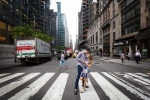 Couple in crosswalk for a New York public library engagement shoot