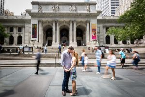 Couple kissing for a New York public library engagement shoot