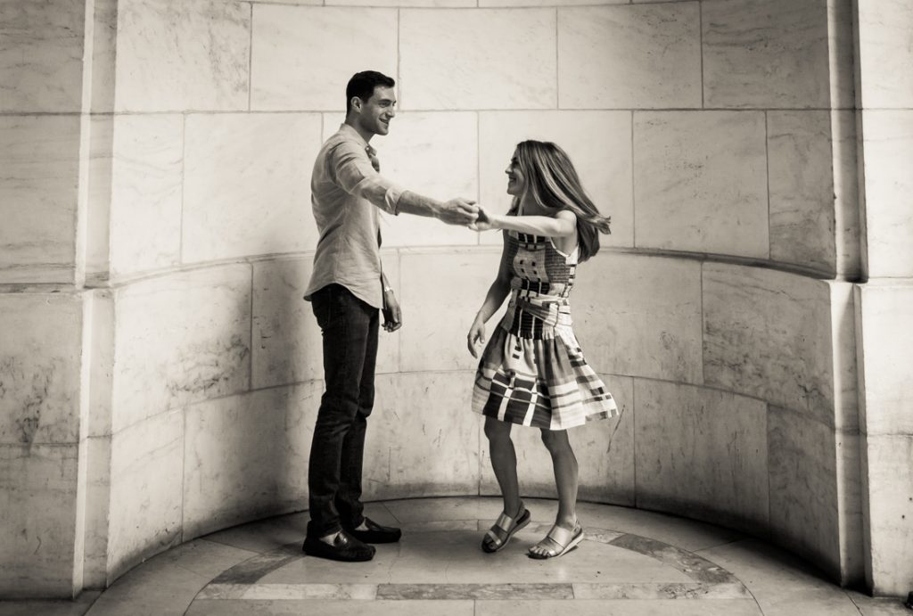 Couple dancing during a New York public library engagement shoot