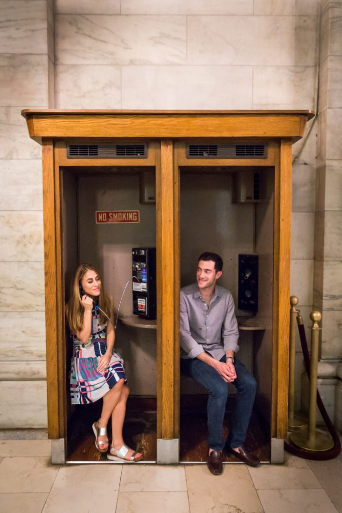 Couple in phone booth New York public library engagement shoot