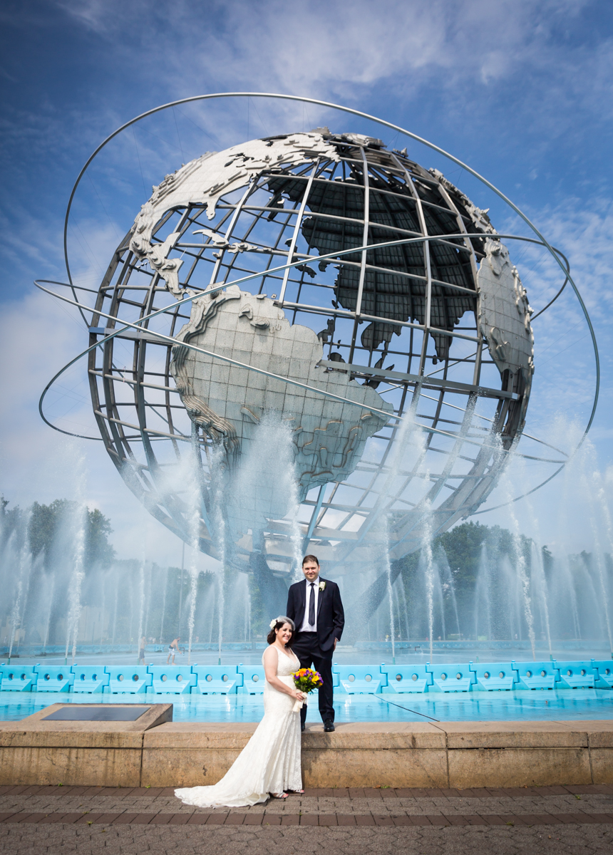 Bride and groom in front of the Unisphere for article on a Terrace on the Park wedding