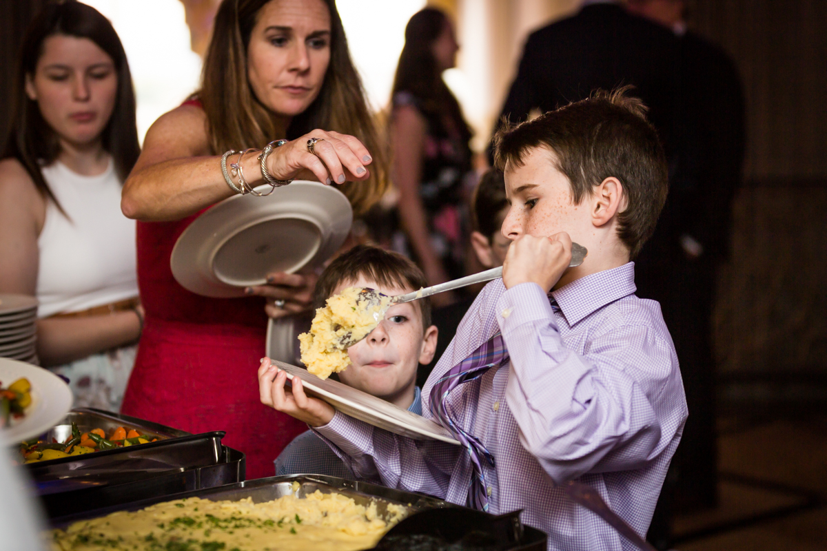 Little boy at buffet for article on a Terrace on the Park wedding