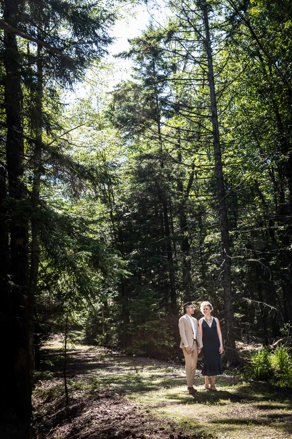 Mother and son walking in the woods during a family reunion portrait