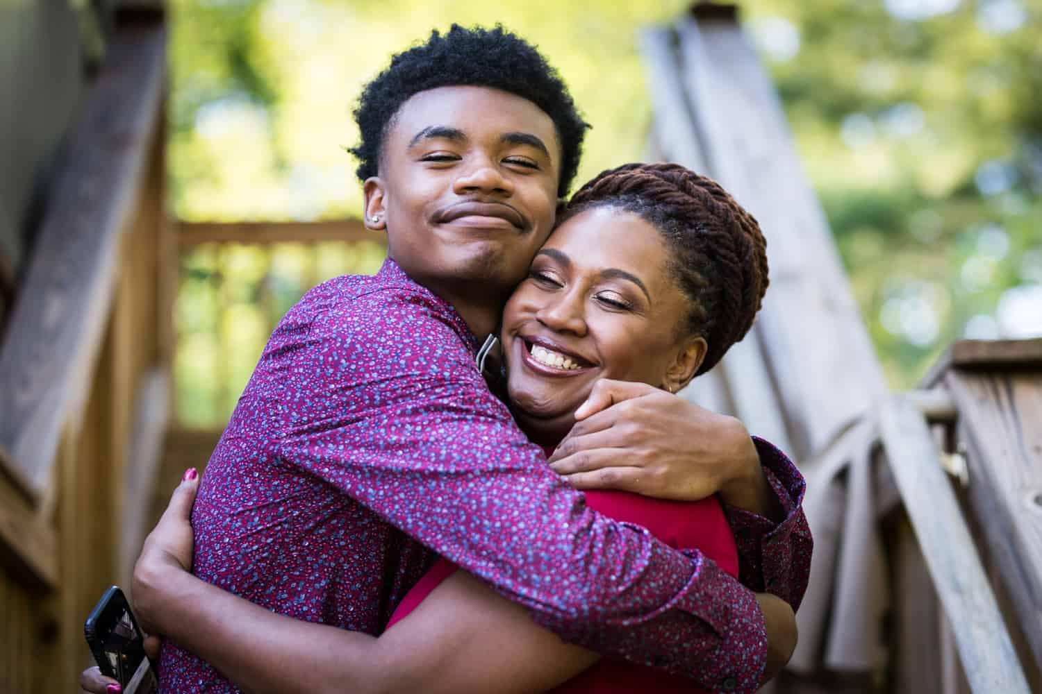 African American mother and son hugging during a family reunion portrait