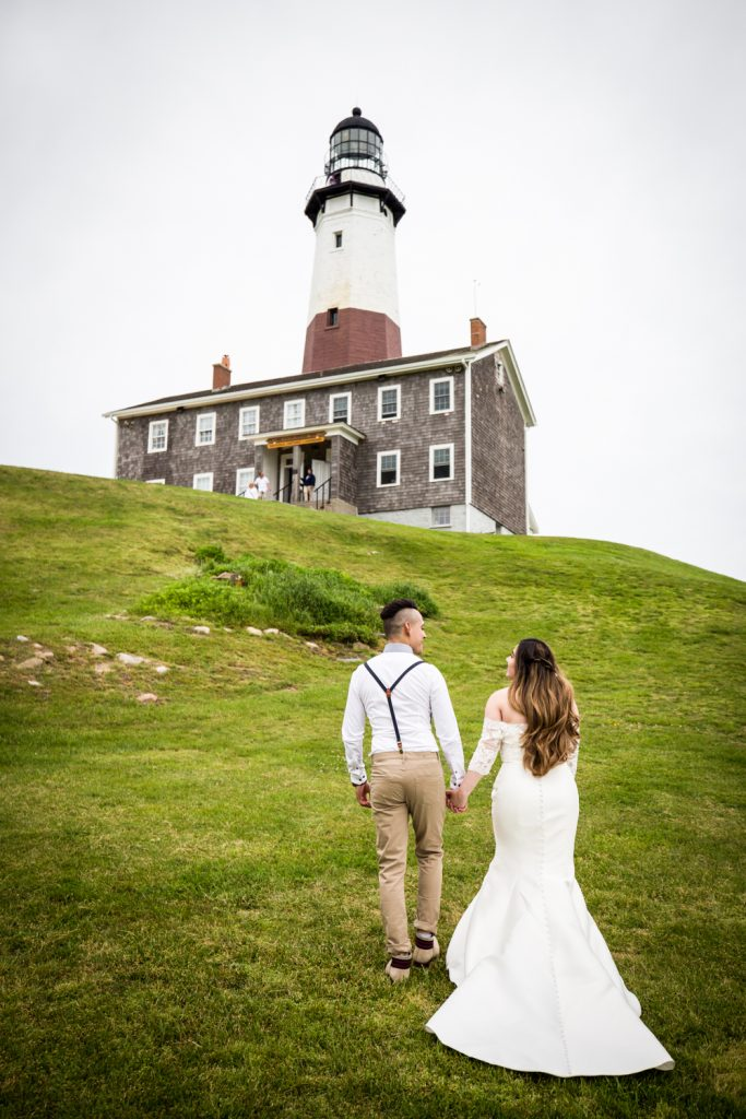 Bride and groom walking for an article on Montauk Lighthouse wedding tips